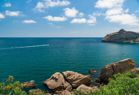Sea aerial view, Top view, amazing nature background.The color of the water and beautifully bright. Azure beach with rocky mountains and clear water of Crimea at sunny day