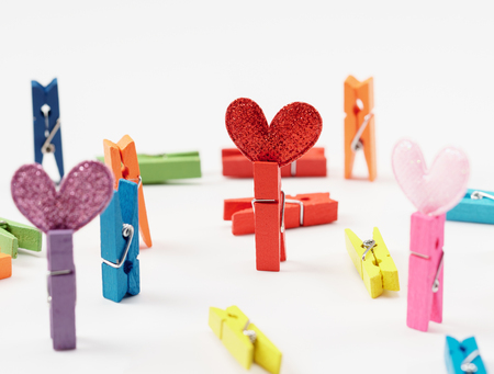 Colourful wooden clothespin with hearts isolated on white background close up. Stok Fotoğraf