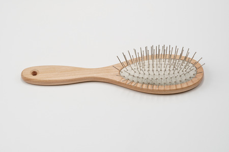 Wooden hair brush on white background. Studio shot, close up. 免版税图像