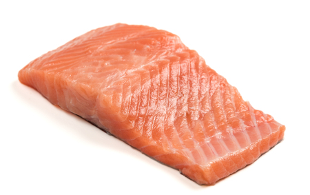 Raw salmon fillet on a white background. Trout fillet without spices. Wild atlantic fish close up