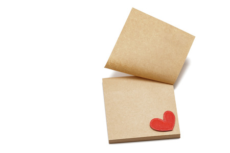 Sticky brown paper notes with a heart. On a white background. Valentine's Day