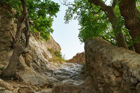 Ancient mountain stone staircase leading to the top of the mountain. Stone stairs leading to the sky. Фото со стока