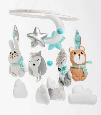 Colorful and eco-friendly children's mobile from felt for children.