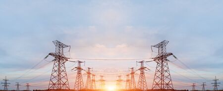distribution electric substation with power lines and transformers, at sunset 스톡 콘텐츠