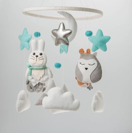 Colorful and eco-friendly childrens mobile from felt for children.