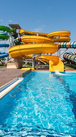 Water park with colorful slides and pools.