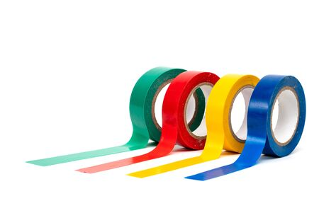 Rolls of insulation adhesive tape, multi colored ribbons on a white background Фото со стока