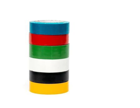 Photo multi colored insulating tapes on a white background.
