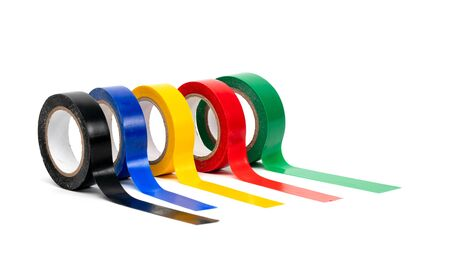 Rolls of insulation adhesive tape, multi colored ribbons on a white background. Bright and colorful insulation tape.