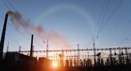 Thermal power stations and power lines during sunset Banco de Imagens
