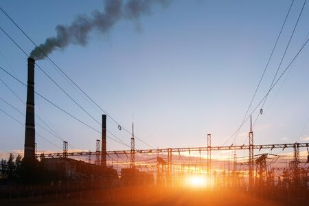 Thermal power stations and power lines during sunset 스톡 콘텐츠