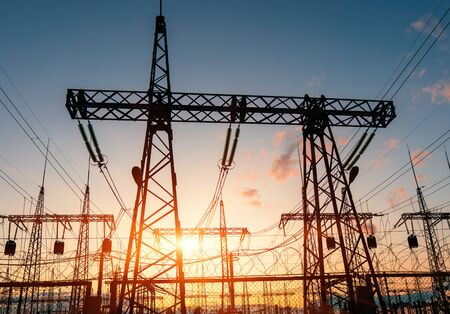 High-voltage power lines. Distribution electric substation with power lines and transformers.