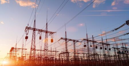distribution electric substation with power lines and transformers, at sunset 版權商用圖片