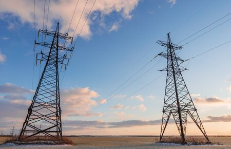 Power lines during a beautiful winter sunset Zdjęcie Seryjne