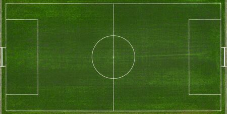 aerial view of a green football field at day time.