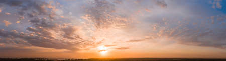 Wide sky panorama with scattered cumulus clouds. 免版税图像