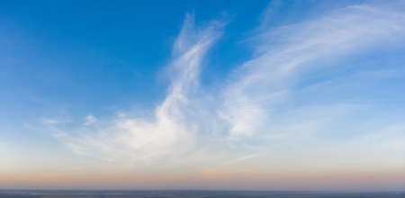 Colorful sky with cirrus clouds during dawn. High resolution panorama. View from above. 免版税图像