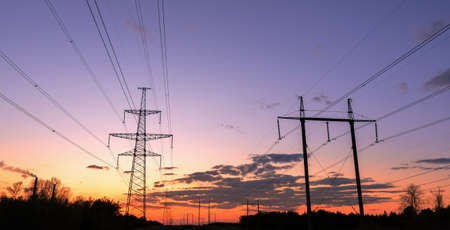 distribution electric substation with power lines and transformers, at sunset 免版税图像