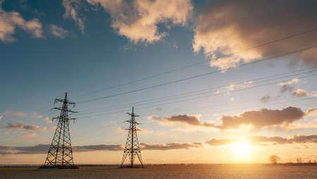 Power lines during a beautiful winter sunset 免版税图像