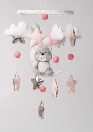 Baby crib mobile - kids toys, on light background