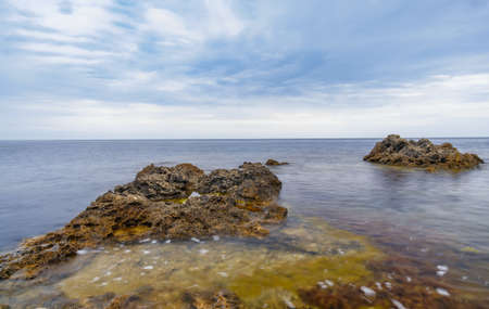 Azure beach with rocky mountains and clear water of Crimea at sunny day