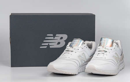 Kiev, Ukraine - January 03, 2021: White women's casual sneakers from New Balance brand on a light background 新闻类图片