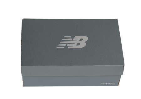 Kiev, Ukraine - January 03, 2021: New Balance sneaker box on a light background. Closed box with brand logo.