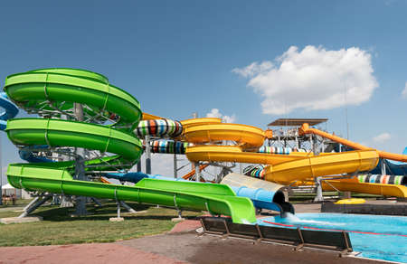 Aquapark slides with pool. Aqua park or water park at day time. 新闻类图片