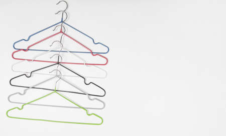 Metal clothes hangers on a light background. Wardrobes were hung for clothes. Place for text.
