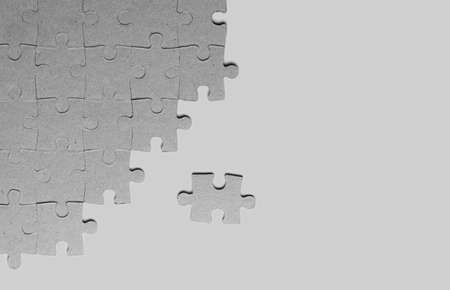 Background from cardboard jigsaw puzzles with place for text The texture of paper or cardboard puzzles.