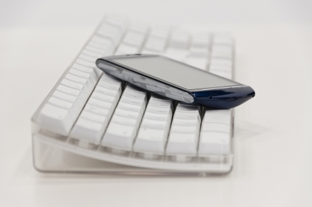 Smart phone and computer keyboard photo