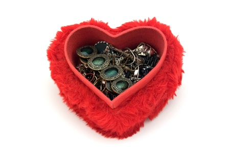 Jewelries in a heart shaped box. photo