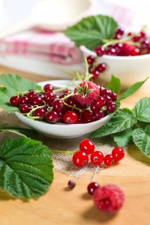 Red currant and raspberry on the glass bowl photo