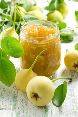marmalade: Pear jam in a glass jar and fresh fruits with leaves