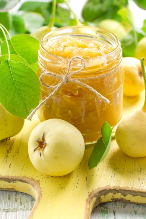 Pear jam in a glass jar and fresh fruits with leaves Stock Photo - 15117104