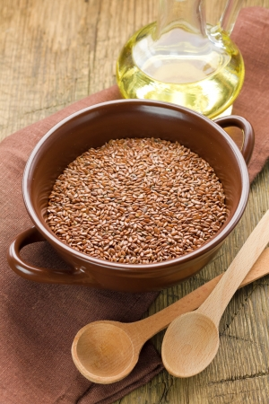 Linseed oil and flax seeds Stock Photo - 15354457