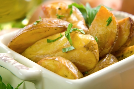 baked potatoes: Rustic oven baked potatoes with parsley Stock Photo