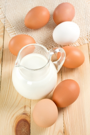 Jug with milk and eggs photo