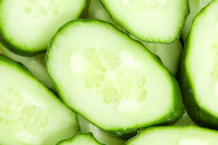 Fresh sliced cucumbers background photo