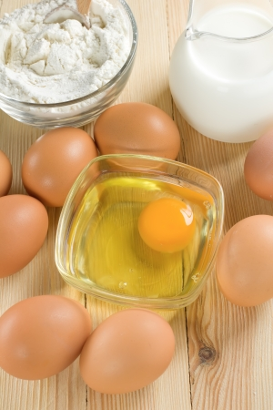 yolk: Basic ingredients for dough. Milk, eggs and flour. Stock Photo