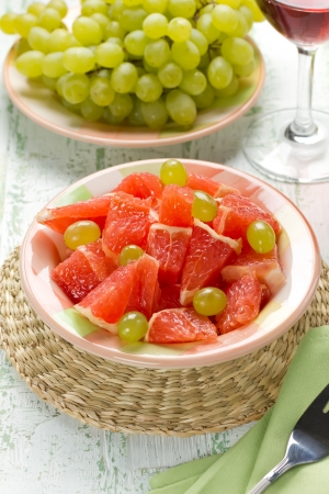 Salad with grapefruit and grapes photo