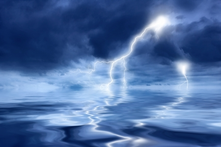 Thunderstorm with lightning in the sea at night photo
