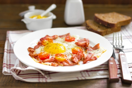 Fried eggs with bacon photo