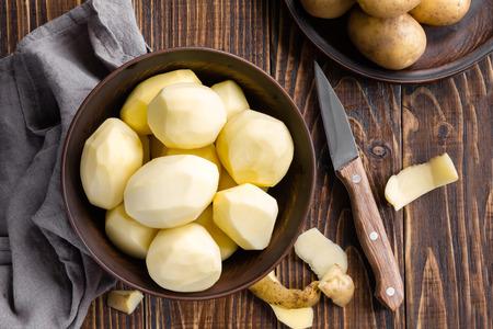 Peeled potatoes Archivio Fotografico