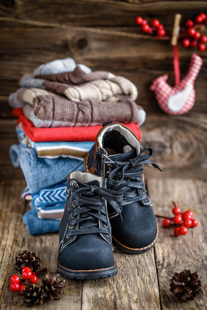 winter clothing: baby clothes and shoes Stock Photo