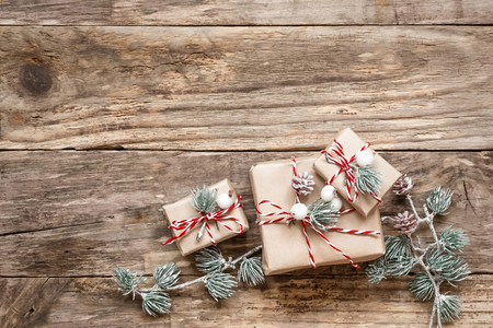 christmas gifts: christmas gifts and decorations on wooden background Stock Photo
