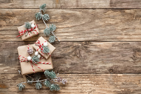 happy holidays: christmas gifts and decorations on wooden background Stock Photo