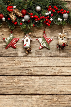 winter card: christmas decorations with ornaments on wooden background