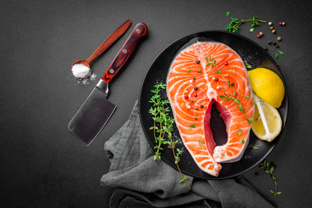 raw salmon fish steak on dark background Stok Fotoğraf