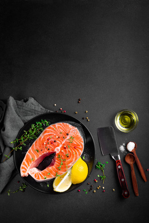 raw salmon fish steak on dark background 스톡 콘텐츠